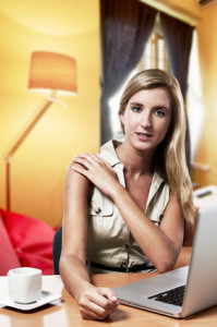 young successful business woman working at home / office